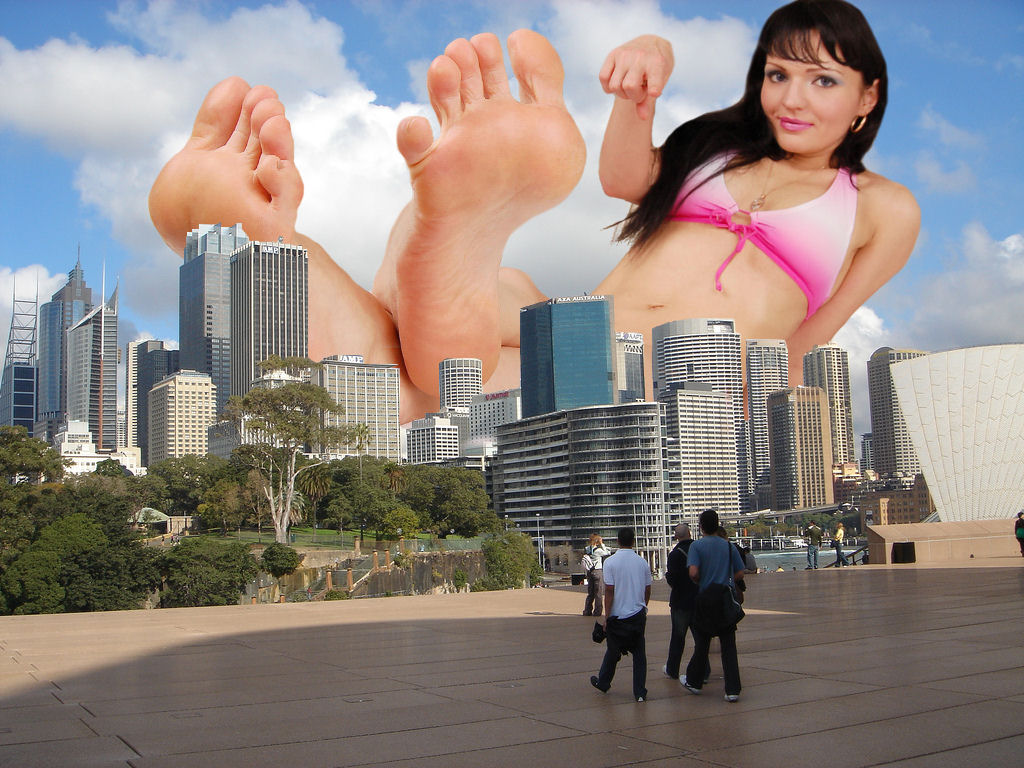 162374 - barefoot brunette city collage giantess looking_at_viewer lying_down pointing small_people soles unknown_artist