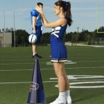 130334 - brunette cheerleader cheerleader_outfit cone gentle giantess holding looking_at_victim love mini_giantess ponytail skirt sleeveless sneakers socks sports standing