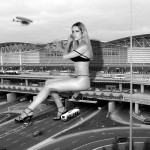 165578 - blonde buildings bus cars city collage crushed_car destruction giantess helicopter high_heels legs looking_at monochrome overpass sitting street suzi_lorraine wonderslug